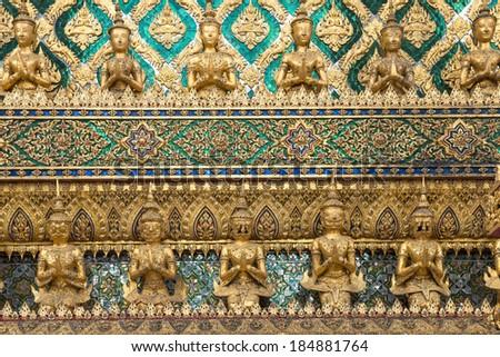 Golden Garuda statues at Wat Phra Kaew - stock photo