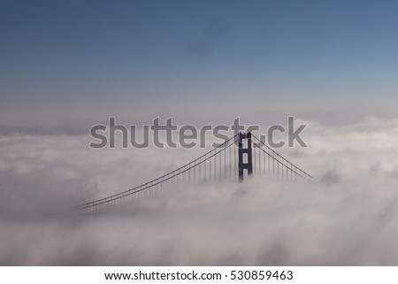 Golden Gate at dawn surrounded by fog, San Francisco, California, USA.