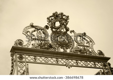 Golden gate at the entrance to the Palace of Versailles, France - stock photo