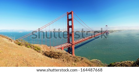 Golden Gate Bridge - a suspension bridge spanning the Golden Gate, the opening of the San Francisco Bay into the Pacific Ocean - stock photo