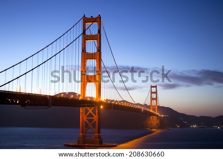 Golden Gate Bridge after sunset with blue skies