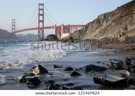 Golden Gate Bridge and a boat at beach - San Francisco - stock photo