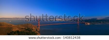Golden Gate Bridge and city skyline at sunset from the Marin Headlands, San Francisco, California - stock photo
