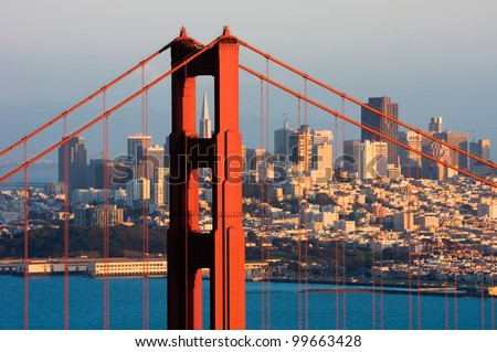 Golden Gate Bridge and downtown San Francisco at sunset - stock photo