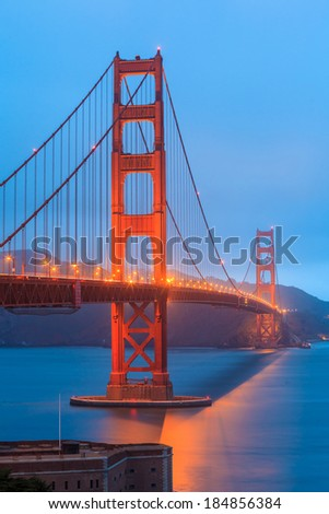 Golden Gate Bridge and downtown San Francisco at twilight - stock photo