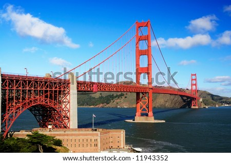 Golden Gate Bridge and Fort Point on a fine winter morning against a backdrop of blue sky with white clouds- landscape orientation. - stock photo