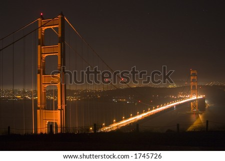 Golden Gate Bridge and San Francisco at Night - stock photo