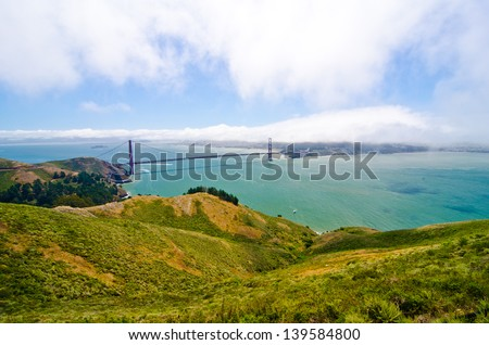 Golden Gate Bridge as taken from Hawk Point at the Golden Gate National Recreation Area with San Francisco in the background. - stock photo