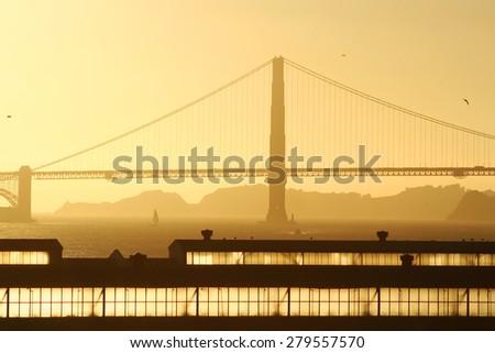 Golden gate bridge at sunset - stock photo