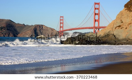 Golden Gate Bridge at Sunset as seen from Baker Beach, California, USA.