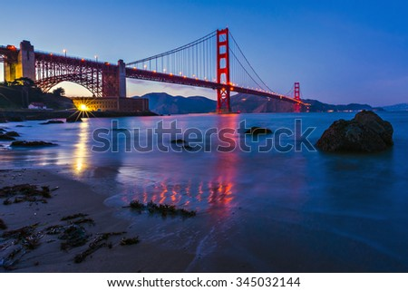 Golden Gate Bridge between San Francisco Bay and the Pacific Ocean seen from Fort Point parking area, San Francisco, California, United States of America