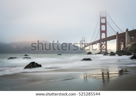 Golden Gate bridge during a misty golden hour