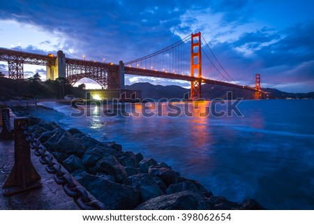 Golden Gate Bridge Dusk At Sunset.  View from Fort Point.  San Francisco, California San Francisco, USA. - stock photo