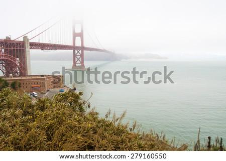 Golden gate bridge in fog - horizontal shot - stock photo