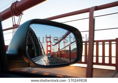 Golden gate bridge in rear view mirror - stock photo