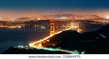 Golden Gate Bridge in San Francisco at night panorama viewed from mountain top - stock photo