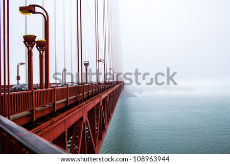 Golden Gate bridge in the fog, San Francisco, CA - stock photo