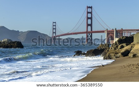 Golden Gate Bridge is shown at  sunset , San Francisco, California - stock photo