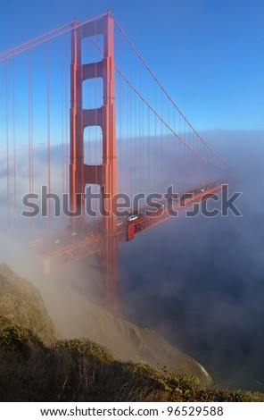 Golden Gate Bridge is shown in a fog , San Francisco, California - stock photo