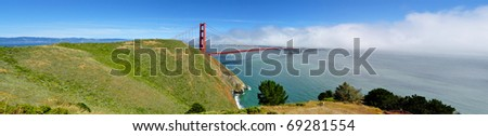 Golden Gate Bridge Panorama from park with fog rolling in from the Pacific Ocean - stock photo