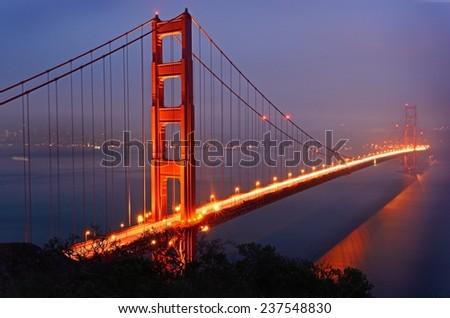 Golden Gate Bridge, San Francisco light trails on a cloudy day - stock photo