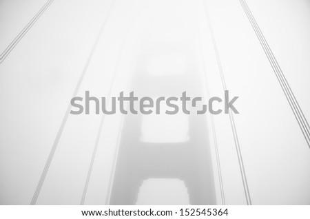 Golden Gate bridge through the fog - stock photo