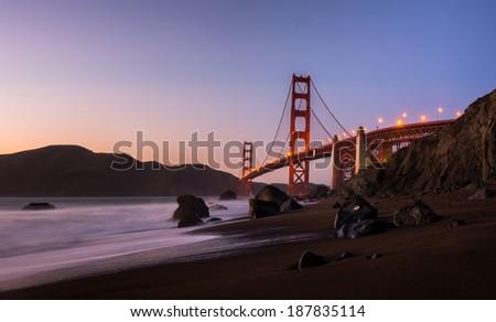 Golden Gate Bridge with Beach at Twilight in San Francisco - stock photo