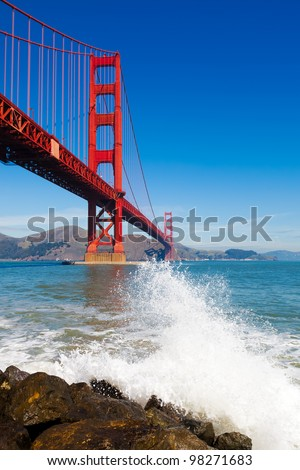 Golden Gate Bridge with spray from ocean wave - in San Francisco, California