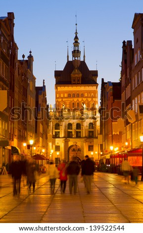 Golden gate in old town at night, Gdansk, Poland - stock photo