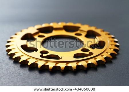 Golden gear on black background. - stock photo