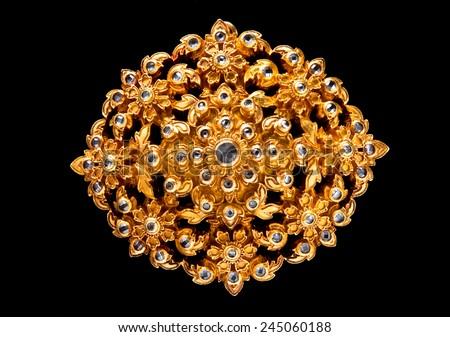 golden gem jewelry isolated on black - stock photo