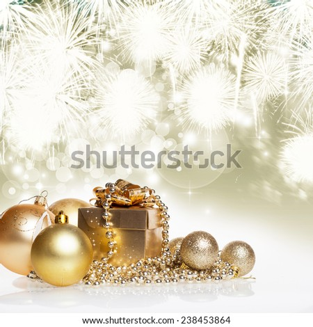 Golden gift box and christmas balls on bokeh background  - stock photo
