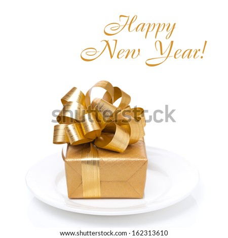 golden gift box on a white plate, concept, isolated on white