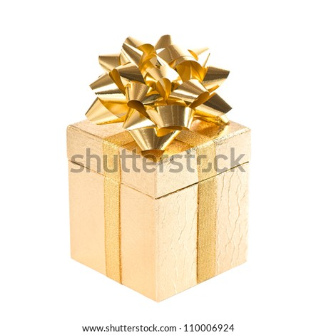 golden gift box with bow on white background