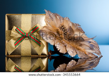 golden gift box with poinsettia - stock photo