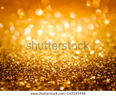 golden glitter and stars for christmas background - stock photo