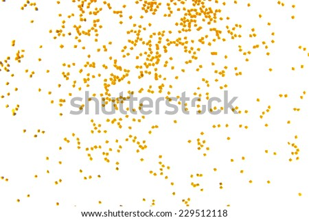golden glitter falling isolated on white - stock photo