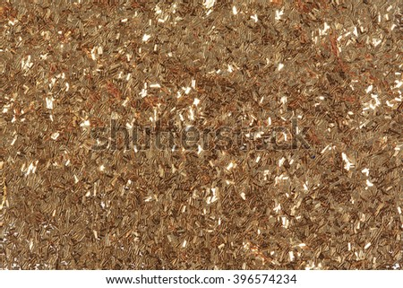 Golden glitter texture, abstract background. Low contrast photo. - stock photo