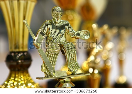Golden goalkeeper ice hockey cup for best player - stock photo