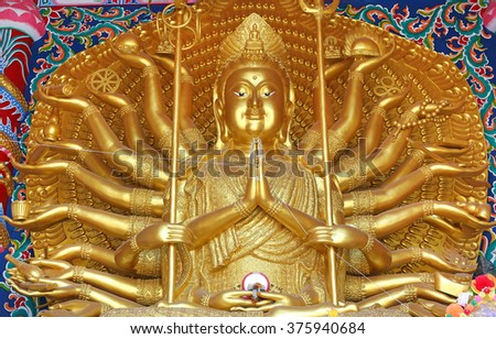 Golden Guanyin Buddha statue with thousand hands in Thailand - stock photo