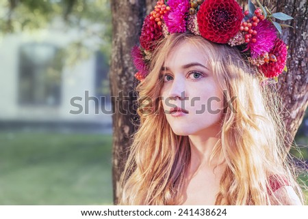 Golden hair woman with red flower wreath - stock photo