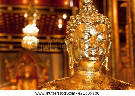 Golden head of meditating Buddha inside the historical Thai temple in city Chiang Mai, Thailand - stock photo