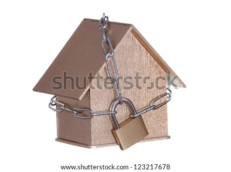 golden home protected with padlock and chain - stock photo