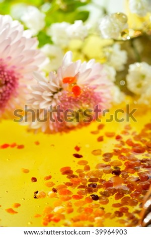 golden honey with pollen and flowers