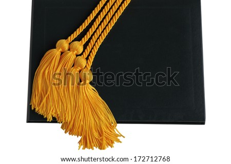 Golden honor graduation cords over black diploma - stock photo