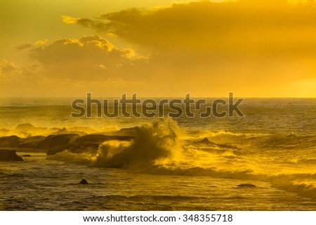 Golden Hour at sunset over the Atlantic Ocean in Essaouira, Morocco. - stock photo