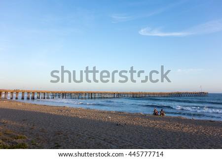 Golden hour at Ventura sandy city beach near famous historic wooden pier, Ventura, California - stock photo