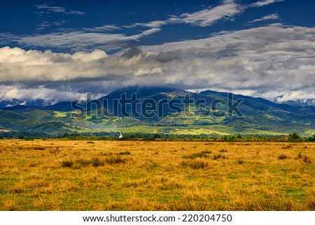 Golden hour panorama landscape from Apuseni mountains, Romania - stock photo