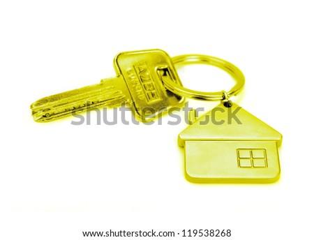 golden house key isolated on white - stock photo