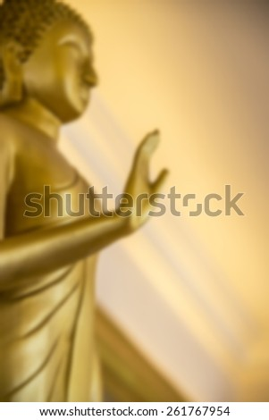 Golden image of Buddha in blur style - stock photo